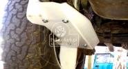 Osłona szutrowa golenia amortyzatora z bardzo odpornego tworzywa do auta wyprawowego