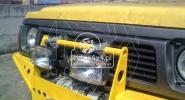 Uchwyt na halogeny do Nissana Patrola Y60